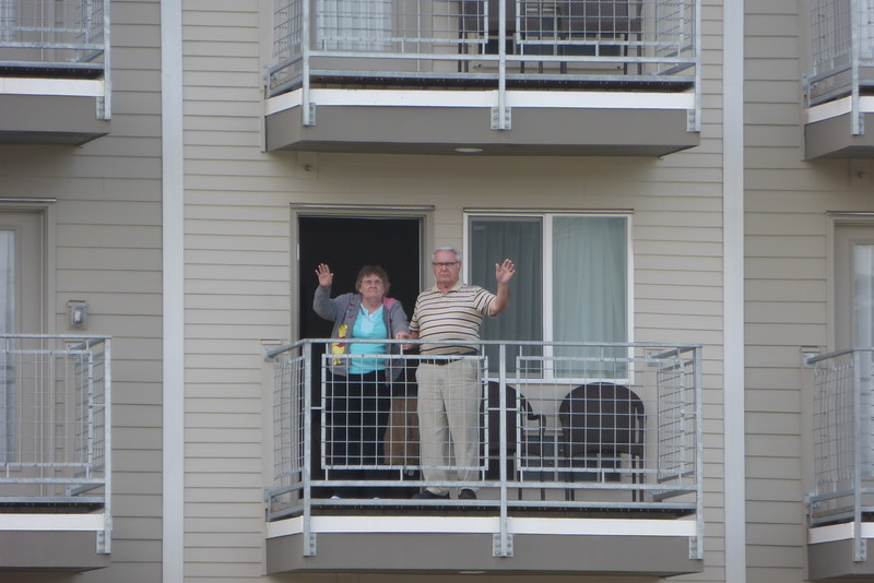 Momma and Pop waving to us across the river.