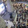 """We were at the rotunda prior to this event..<br /> <br /> Man Cited After Tossing $1,000 Into MOA Rotunda<br /> November 30, 2013 9:52 AM<br /> <a href=""""http://minnesota.cbslocal.com/2013/11/30/man-cited-after-tossing-1000-into-moa-rotunda/"""">http://minnesota.cbslocal.com/2013/11/30/man-cited-after-tossing-1000-into-moa-rotunda/</a><br /> """"...BLOOMINGTON, Minn. (WCCO) – You know the old saying: money doesn't fall from the sky?  Well, it did on Black Friday at Mall of America.<br /> <br /> Serge Vorobyov — who goes by the YouTube handle """"Serge the Car Hauler"""" — threw $1,000 in dollar bills from the fourth floor of the Mall of America rotunda as a choir performed """"Let it Snow"""" on the ground floor below.<br /> <br /> Serge said the reason he surprised everyone and tossed out the cascade of cash is because he's had a rough year and just wanted to help other people on Black Friday....""""<br /> <br /> Explanation Behind the Black Friday 1000 $ Drop <br /> <a href=""""http://youtu.be/mduF3B2Sky4"""">http://youtu.be/mduF3B2Sky4</a><br /> <br /> Minn. Man Ticketed For Making It Snow Money At Mall Of America<br /> <a href=""""http://kuer.org/post/minn-man-ticketed-making-it-snow-money-mall-america"""">http://kuer.org/post/minn-man-ticketed-making-it-snow-money-mall-america</a><br /> <br /> Crazy Guy Throws $ 1,000 Dollars off 4th Floor at Mall of America <br /> <a href=""""http://youtu.be/TcaivzsC39w"""">http://youtu.be/TcaivzsC39w</a>"""