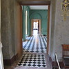 hallway viewed from vestibule looking towards the salle de billard next room on right.