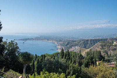 The harbor at Taormina. Our ship in anchored near a breakwater. Mt. Etna to the right.