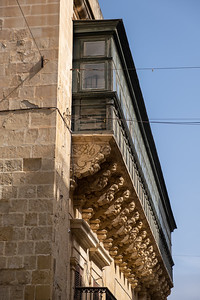 Homes in Valleta often have elaborate, enclosed balconies.
