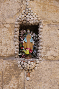 Small shrine in the wall of a house in the Collachio area of Vittoriosa
