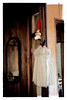 Two little white dresses hang in silent testimony to summers past.
