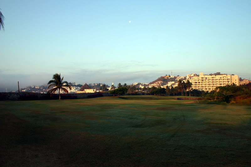 This is the seventeenth hole of the golf course with Karmina Palace Hotel on the right and Las Hadas behind the palm tree on the left.