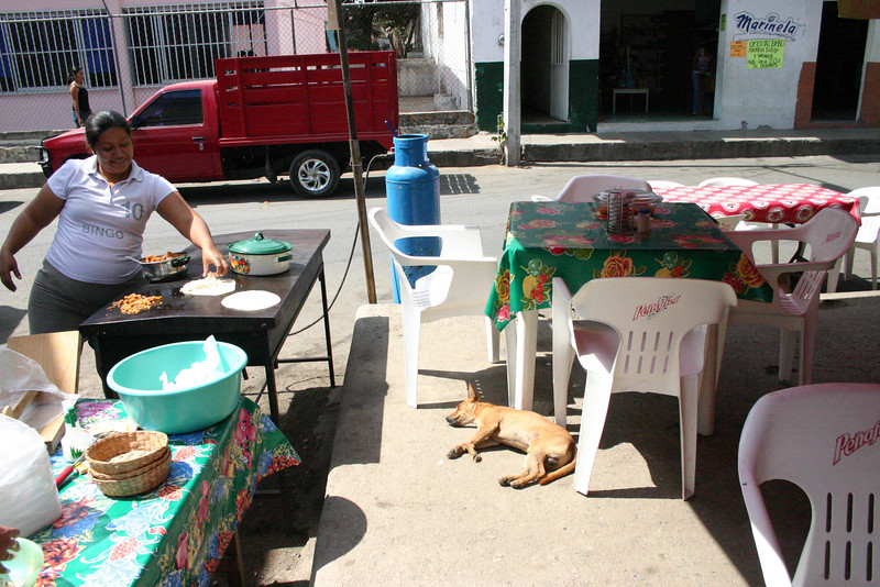 After the flea market we went for drinks at this open air snack bar.  We watched the owner making tortillas as her dog dozed in the sun and we pined for Sandy.