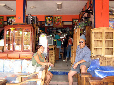 One of the local furniture shops.  Very rustic. If they don't have it, they will make it for you.  For the non-Spanish visitor, cajones and cojones are very different things!  You want to use CAJONES at the furniture store.