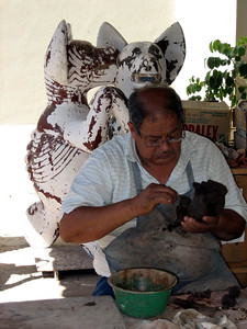 Althought not the original creater of the Colima dog, Artist _ is responsible for new poses.  He was working on a new pose during our visit.  Museo de Artes Populares (Museum of Popular Art)