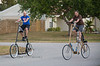 Pat Going for a tall bike ride with Ken Prather, founder of the Freak Bike Militia