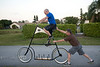Ken Prather giving Too Tall Pat a hand steadying the Freak Bike