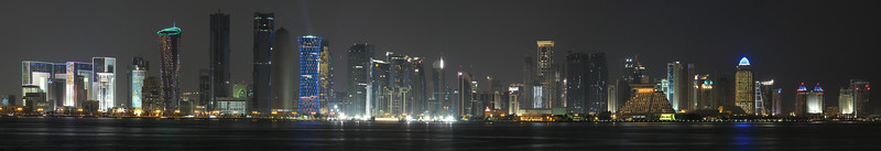 Night skyline, Doha, Qatar. From Museum of Islamic Art park. November 2010. Canon G12, five horizontal photos, on tripod. Processed in Autopano Pro and Aperture2.