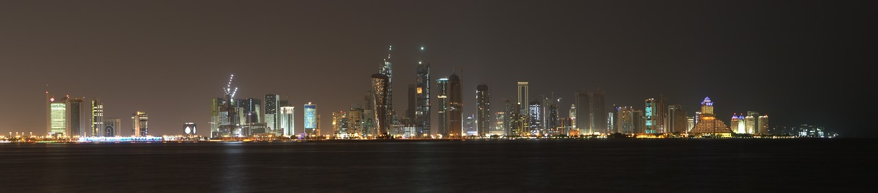 Night skyline, Doha, Qatar. From Amiri Dewan pier. November 2009. Canon 20D, six horizontal photos, on tripod. Processed in Autopano Pro and Aperture2.