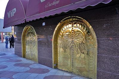 A bar with gold doors