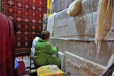 Women making hand-made carpets. Some of the carpets in this shop did cost over 3000 euro!