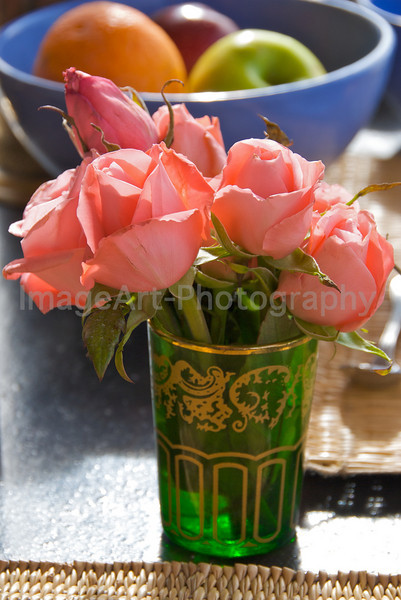Pink roses in a mint tea glass, Morocco