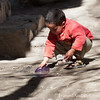 <b><center><em> Little boy playing on a side street in Marrakesh.