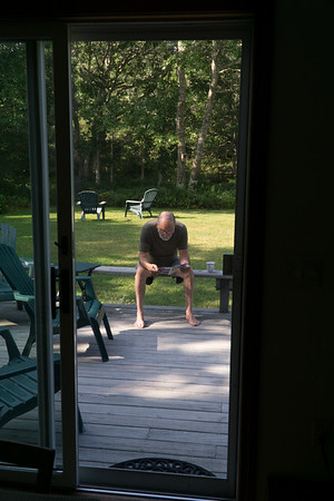 Al's reading out on the deck.