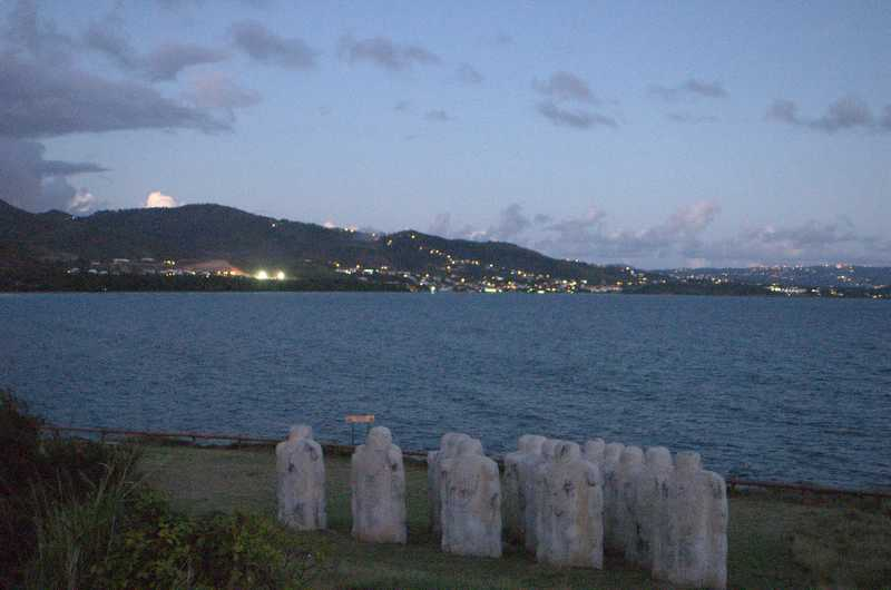 A memorial to slaves who were chained in the hold of a ship that hit the reef  in Anse Cafard and sank with them still on board. The lights are the village of Diamant. Our villa overlooks Anse Cafard, and our porch is at 14.46376N, 61.04740W for those interested in Google Earth or Maps. This memorial is visible as a triangle of white shapes: