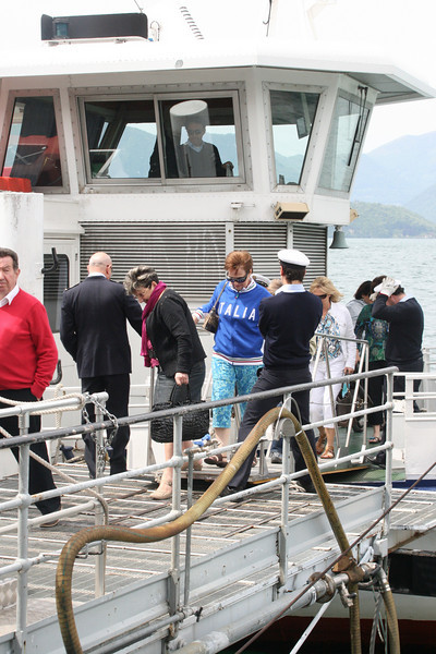 Pat disembarks (with the jacket she had to buy at last minute due to chilly weather).