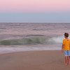 Boy watching the ocean surf at Ocean City Md