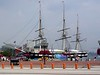 """<b>USS Constellation</b> - The United States Navy built three ships with the name USS Constellation, honoring, according to the U.S. Congress, the """"new constellation of stars"""" on the United States flag.  Baltimore's <i>World Trade Center</i> is in the background. (July 31, 2006)"""