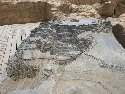Model of Masada, showing the water channels that brought water to storage areas.  on the upper left cliff face of the model you can see Herod's palace.