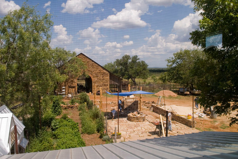 view from,builders upstairs towards their historic barn, where they are going tohave a kitchen and teach cheesemaking classes.<br /> building a pizza oven outside which is under the blue tarp, also patio area