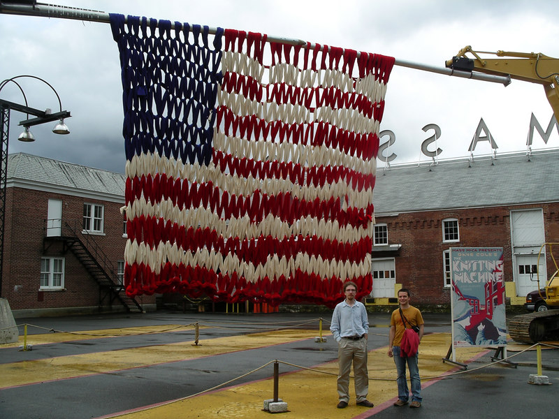 This was a large crochet flag by Dave Cole made by The Knitting Machine which consisted of two excavators each with a 30 ft needle on them.  During the making Cole was on a cherry picker and used a large hook to thread the yard.