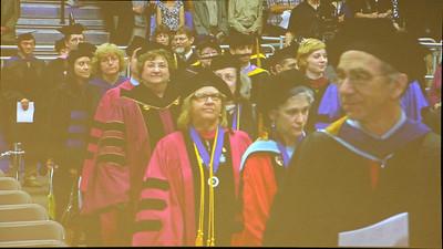 Faculty entering the center . . . [jumbotron photo]
