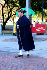 Tour Guide dressed in Colonial-era Garb in Boston Common (drinking Starbucks)