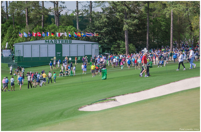 Times Square at Augusta National. The clubhouse is behind me; the master scoreboard and one and nine are in your view.