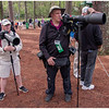 The friendly photographer man and his assistant prepared for any unexpected moment, with four cameras and related gear