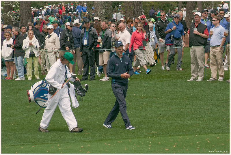 Kaymer chuckling with his caddy after teeing off on 7,  Pampas.