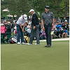 Couples practicing putting on 7 along with Bill  Haas and Hunter Mahan.