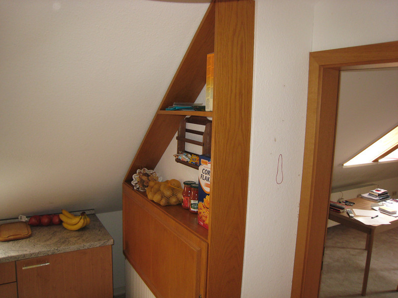 Part of my kitchen, notice the sloped ceiling, not so great for tall people.