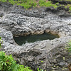 One of the sacred pools. You can see how the river has carved out these pools from the volcanic rocks.