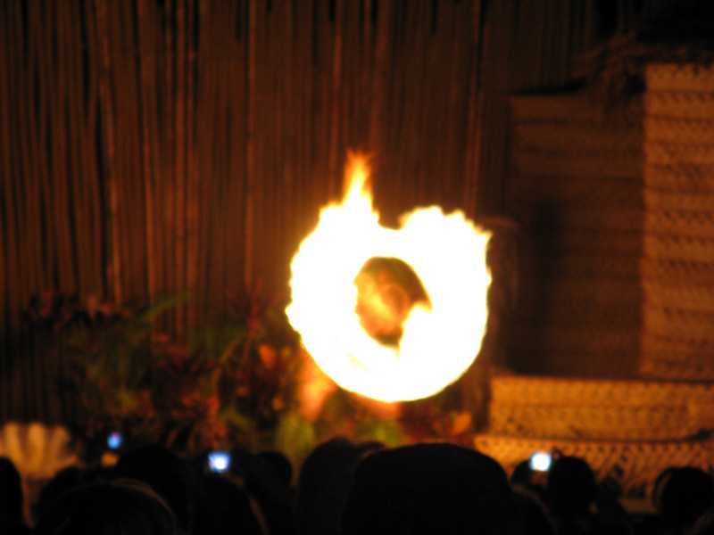 Now the men dancers start twirling fire batons.