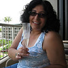 Christine with a glass of champagne from the hotel for our 20th anniversary.