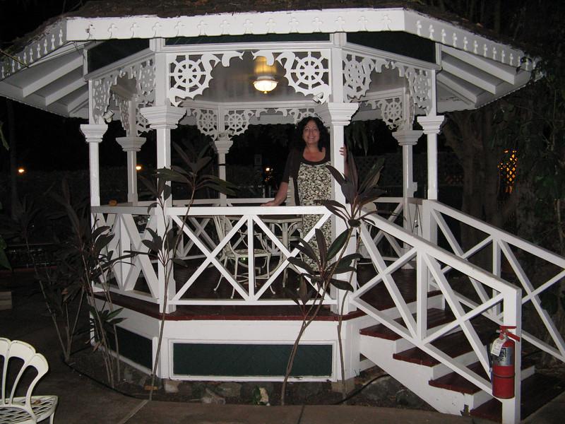 Christine in the little gazebo that Grandpa Joe built when he lived on Maui.
