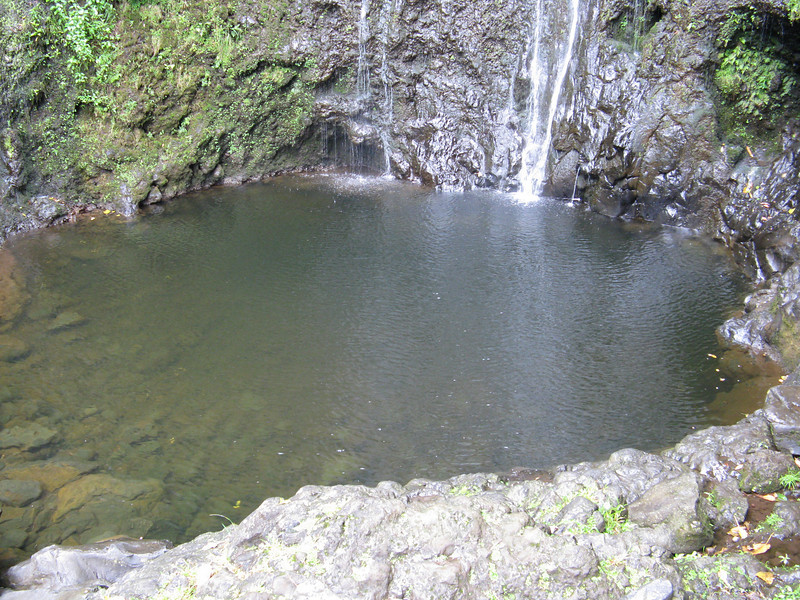 Deep pool at the base of the waterfall.