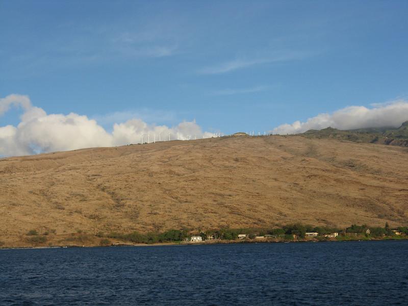 The ridge has a bunch of wind turbines.