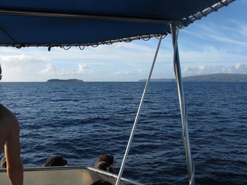 Molokini is the small island. To the right is Kahoolawe Island, which was used by the military as a bombing range.