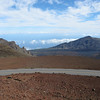 The crater at the top of the volcano could hold a very large city. It was huge and desolate.