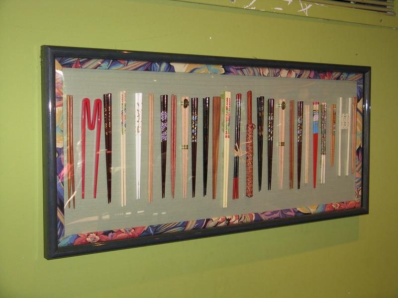 Chopsticks as art on the wall.
