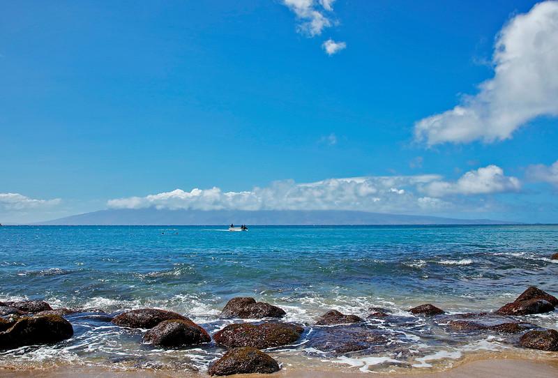 To the West of Kahana lies the island of Lana'i.