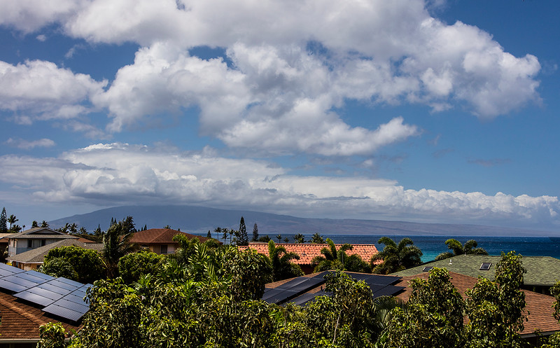 We spend our week in the town of Kahana. Looking west from our balcony  we could see the island of Lana'i .
