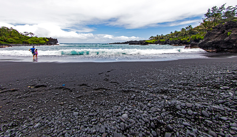 On the black sand beach.