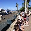 Visitors waiting in line to board a boat for whale watching expedition in Maui, Hawaii.