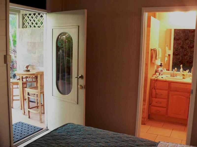 Maui Sunseeker room 104 bedroom, bath and back lanai