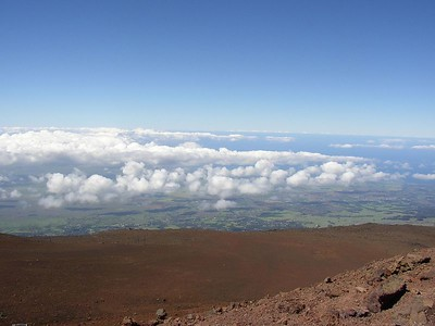 The summit of Haleakala with views of southwest Maui below.