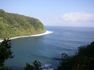 View of Honomanu Bay with the Hana Highway along the mountainside to the left.